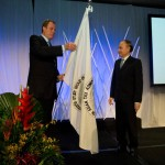 Commissioner Jordan handing the SGATAR flag to Commissioner Tan